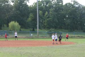 girls playing on a baseball field