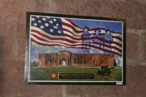 framed photo of an American flag and guard members