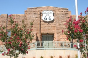 Route 66 sign on the outside of a brick building