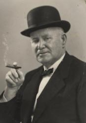 Bennie Kent in a top hat with a cigar