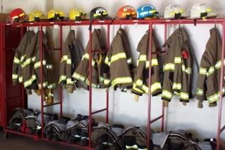 firefighter's uniforms hanging