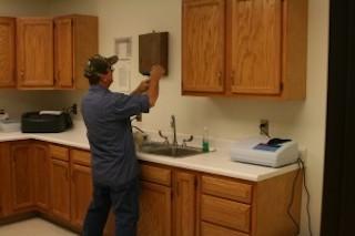 man repairing a sink